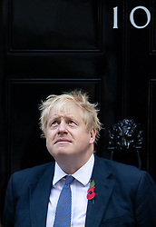 © Licensed to London News Pictures. 28/10/2019. London, UK. British Prime Minister Boris Johnson buys a poppy from fundraisers for the Royal British Legion on the doorstep of 10 Downing Street. Photo credit : Tom Nicholson/LNP