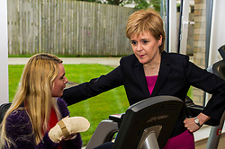 Pictured: Nicola Sturgeon met an old school friend, Lorraine Hill, who was at the same primary and secondary school<br /> <br /> The First Minister Nicola Sturgeon, MSP, joined people supported by the Thistle Foundation to bury a time capsule to mark the opening of a new health and social care centre. <br /> Ger Harley | EEm 14 June 2016