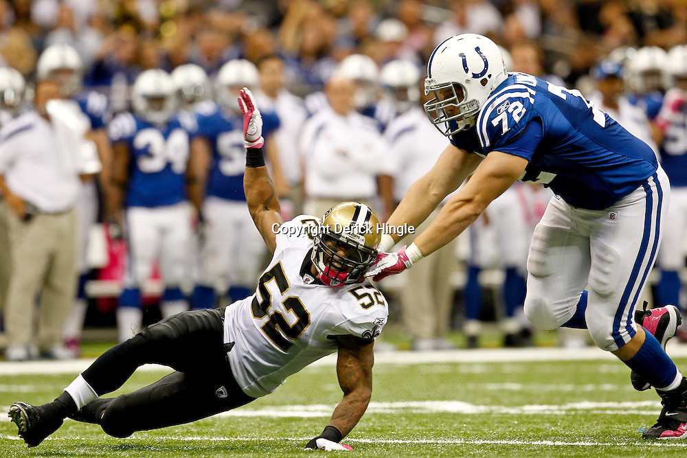 October 23, 2011; New Orleans, LA, USA; New Orleans Saints linebacker Jonathan Casillas (52) is blocked by Indianapolis Colts offensive tackle Jeffrey Linkenbach (72) against the Indianapolis Colts during the third quarter of a game at the Mercedes-Benz Superdome. The Saints defeated the Colts 62-7. Mandatory Credit: Derick E. Hingle-US PRESSWIRE / © Derick E. Hingle 2011