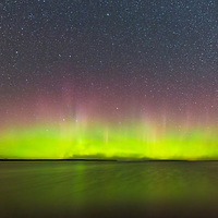 Bright display of the northern lights looking across Lake Superior from Michigan Island