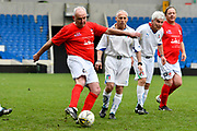 Neil Evans of England over 50's scores a goal to give a 1-0 lead to the home team during the world's first Walking Football International match between England and Italy at the American Express Community Stadium, Brighton and Hove, England on 13 May 2018. Picture by Graham Hunt.