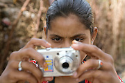 Pooja, 14, a student from the village of Pathpuri, Hoshangabad, Madhya Pradesh, India, taking part to the children's journal, a project launched by Dalit Sangh, an NGO which has been working for the uplift of scheduled castes for the past 22 years, is using a digital camera provided by the project to child reporters. Dalit Sangh is working in collaboration with Unicef India to promote education and awareness within backward communities.
