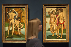 "© Licensed to London News Pictures. 28/02/2019. LONDON, UK. A staff member views ""Figures in a Landscape: Two Nude Youths"" and ""Man, Woman and Child"", both c1490 by Luca Signorelli. Preview of ""The Renaissance Nude"", an exhibition at the Royal Academy of Arts in Piccadilly of 90 works examining the emergence of the nude in European art.  Works by artists including Leonardo da Vinci to Michelangelo are on display in the Sackler Galleries 3 March to 2 June 2019.  Photo credit: Stephen Chung/LNP"