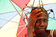 Portrait of a woman holding a colorful umbrella outside the Tabacongo health center, in the town of Tabacongo, Katanga province, on Sunday February 19, 2012.