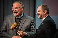 The Rev. Dr. Daniel Harmelink, executive director of Concordia Historical Institute (right), presents the gavel to the Rev. Dr. Matthew C. Harrison, president of the LCMS, during the 66th Regular Convention of The Lutheran Church–Missouri Synod on Sunday, July 10, 2016, at the Wisconsin Center in Milwaukee. LCMS/Michael Schuermann