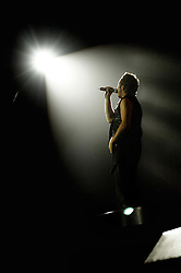 "Shane Filan in the spotlight during when Westlife play their third consecutive concert at the Hallam FM Arena at the start of their ""Unbreakable"" Tour 2003 Monday 21st July 2003<br /> <br /> Image Copyright Paul David Drabble<br /> 21 July 2003"