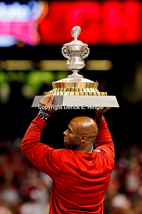 Jan 2, 2013; New Orleans, LA, USA; Louisville Cardinals head coach Charlie Strong holds up the Sugar Bowl trophy following a win against the Florida Gators in the Sugar Bowl at the Mercedes-Benz Superdome. Louisville defeated Florida 33-23. Mandatory Credit: Derick E. Hingle-USA TODAY Sports