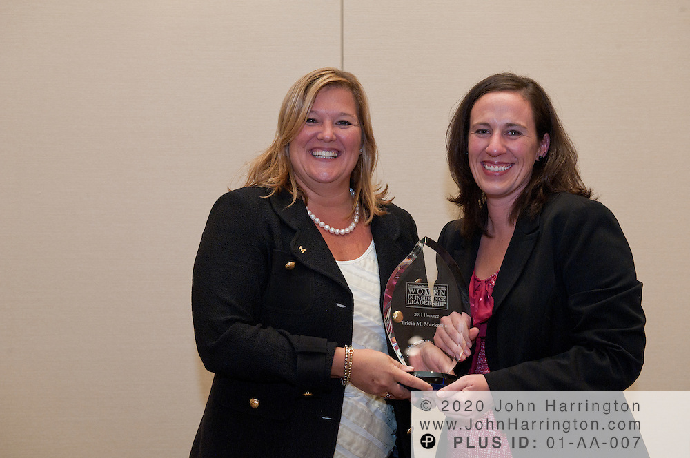 Tricia Mackechnie (L), SVP and CIO Consumer Markets & Enterprise Operations Technology receives the WIL Honoree Award from Carrie Burns (R), Editor, INN at the Women in Insurance Leadership Forum at the National Harbor in Maryland on September 18th, 2011.
