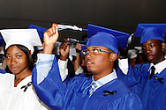 Graduates turn their tassels during the Paul Laurence Dunbar High School commencement in the Dayton Convention Center in downtown Dayton, Wednesday, May 23, 2012.