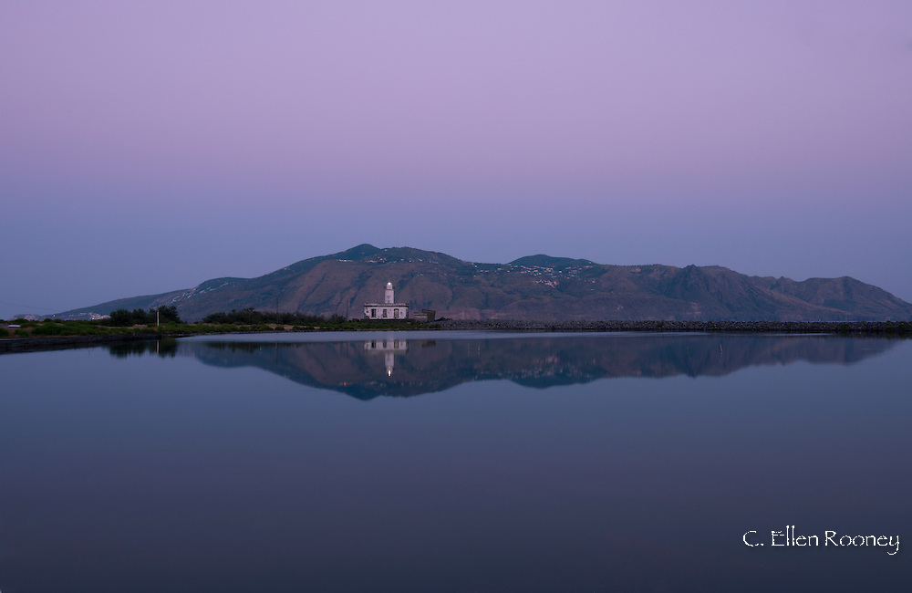 The Punta Lingua Lighthouse at dusk on the island of Salina in the Aeolian Islands, Sicily, Italy