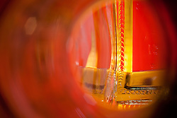 """Beauty at the Bottom: Tequila Sunrise 3"" - This image is a photograph of a tequila bottle looking right down the mouth of the bottle."