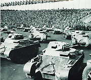 German militarisation during 1936.  Parade of tanks at a Nazi rally.