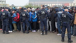October 24, 2016 - Calais, Northern France, France - Image ©Licensed to i-Images Picture Agency. 24/10/2016. Calais, France. Calais Jungle Eviction. Riot police struggle to gain control as a crush develops when migrants and refugees line up to be processed and then bussed out out to reception centres across France. It is estimated that 3000 refugees and migrants to be processed. Picture by Pete Maclaine / i-Images (Credit Image: © Pete Maclaine/i-Images via ZUMA Wire)