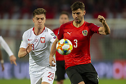 March 21, 2019 - Vienna, Austria - Aleksandar Dragovic of Austria fights for the ball with Krzysztof Piatek of Poland during the UEFA European Qualifiers 2020 match between Austria and Poland at Ernst Happel Stadium in Vienna, Austria on March 21, 2019  (Credit Image: © Andrew Surma/NurPhoto via ZUMA Press)