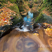 Waterfall cascade during autumn foliage.