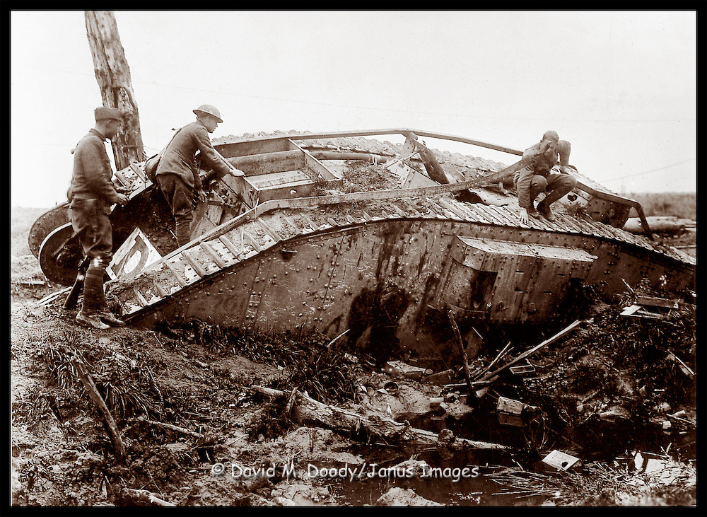 American soldiers on a damaged World War One tank.
