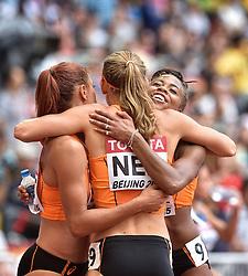29-08-2015 CHN: IAAF World Championships Athletics day 7, Beijing<br /> Het Nederlandse vrouwenestafetteteam heeft zich geplaatst voor de finale van de 4x100 meter bij de WK atletiek in Peking. Het kwartet, met wereldkampioene Dafne Schippers als tweede loopster, eindigde als derde in de serie en die klassering was voldoende voor een finaleplek. Oranje noteerde bovendien een Nederlands record van 42,32 seconden. Vreugde bij Naomi Sedney , Nadine Visser en Jamile Samuel Photo by Ronald Hoogendoorn / Sportida