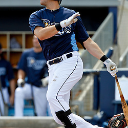 March 21, 2012; Port Charlotte, FL, USA; Tampa Bay Rays third baseman Evan Longoria (3) hits a fly out against the New York Yankees during the bottom of the first inning of a spring training game at Charlotte Sports Park.  Mandatory Credit: Derick E. Hingle-US PRESSWIRE