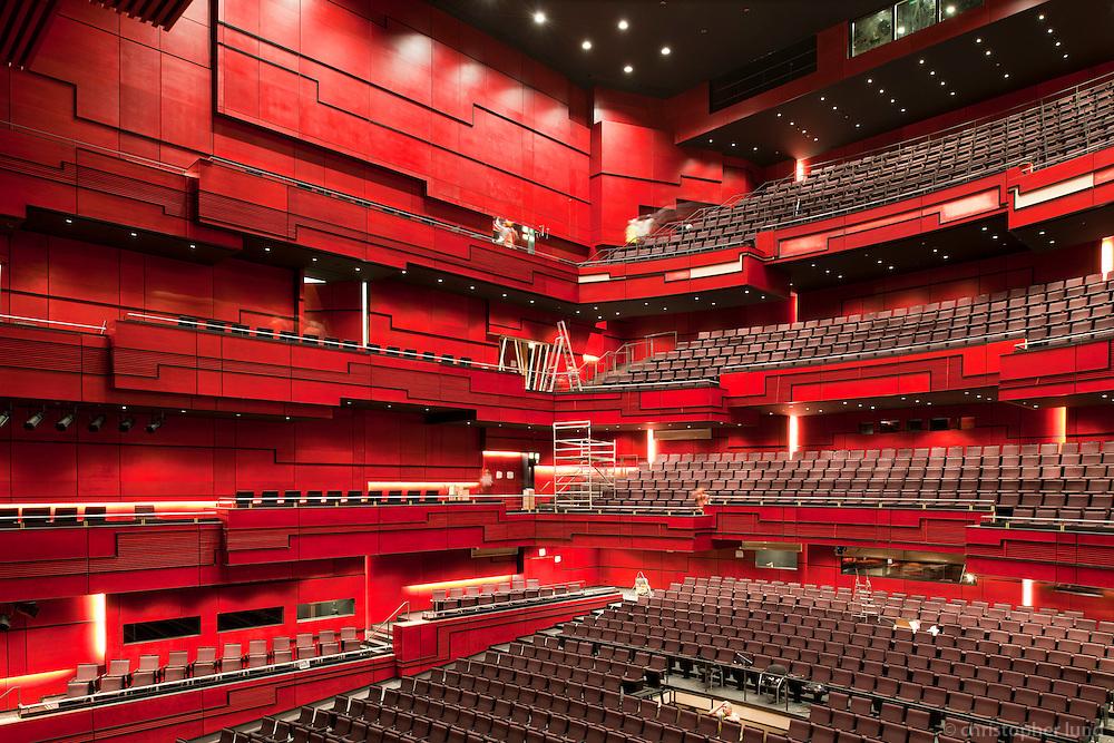 Harpan - Eldborg. Salurinn er klæddur rauðum við frá Axis. Eldborg Music Hall at Harpan, Reykjavik Iceland.