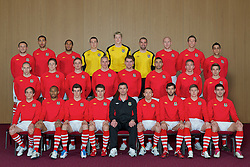 CARDIFF, WALES - Tuesday, March 22, 2011: Wales' players pose for a team group photograph at the Vale of Glamorgan Hotel...Back row L-R: Neal Eardley, Lewin Nyatanga, Ashley Williams, goalkeeper Lewis Price, goalkeeper Wayne Hennessey, goalkeeper Boaz Myhill, James Collins, Danny Collins, Neil Taylor...Middle row L-R: Andrew Crofts, Chris Gunter, Andy King, Steve Morison, Sam Vokes, Hal Robson-Kanu, Freddie Eastwood, Joe Allen...Front row L-R: David Vaughan, Daniel Gabbidon, Gareth Bale, Aaron Ramsey, manager Gary Speed MBE, Craig Bellamy, Joe Ledley, Simon Church, Ched Evans...(Photo by David Rawcliffe/Propaganda)