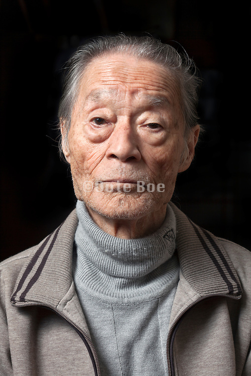 portrait of elderly Japanese man looking straight at the camera