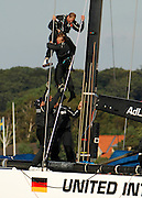 United Internet Team Germany sailor Christian Buck who had been swung like a rag doll after losing his grip up the mast of GER72 is helped to the deck by a fellow crewman. Louis Vuitton Act 6. Malmo, Sweden. 26/8/2005