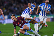 Javier Hernandez of West Ham United (17) screams in pain as he goes down from a challenge from Mathias Zanka Jrrgensen of Huddersfield Town (25) during the Premier League match between Huddersfield Town and West Ham United at the John Smiths Stadium, Huddersfield, England on 10 November 2018.