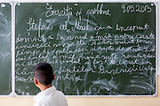 Pupil at the board in one of the local schools in Frumusina. In Frumusani, the Roma Education Fund—supported by the World Bank, Open Society Foundations, the European Union, and other donors—is working to remove the barriers local Roma children face to complete their primary school education.