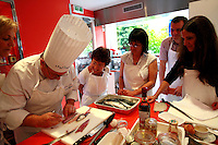 "Lenotre Ecole Culinaire, Paris,..short course - ""Return to the Market"" with Chef Jacky Legras.Chef demonstrates fileting the mackerel...photo by Owen Franken for the NY Times..July 12, 2007......."