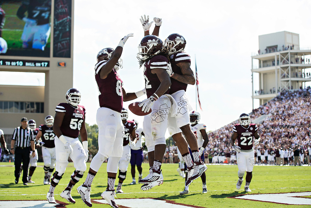 STARKVILLE, MS - SEPTEMBER 19:  Ashton Shumpert #32 of the Mississippi State Bulldogs celebrates with teammates after scoring a touchdown during a game against the Northwestern State Demons at Davis Wade Stadium on September 19, 2015 in Starkville, Mississippi.  The Bulldogs defeated the Demons 62-13.  (Photo by Wesley Hitt/Getty Images) *** Local Caption *** Ashton Shumpert