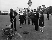 1983-07-05.5th July 1983.05-07-1983.07-05-83..Bushes and Saplings:..Photographed at US Embassy Residence, Dublin..George Bush, US Vice President, with wife, Barbara, planting a sapiing in the grounds of the US Embassy  Residence.
