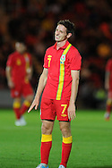 Joe Allen of Wales reacts as he misses a chance. Friendly international football, Wales v Bosnia- Herzegovina  at Parc y Scarlets in Llanelli ,  South Wales on Wed 15th August 2012. pic by Andrew Orchard, Andrew Orchard sports photography,