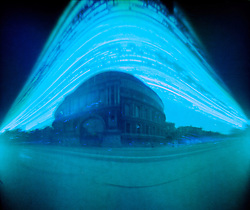© licensed to London News Pictures. London, UK. World Pinhole Day 24th April 2011. Solargraph pinhole photograph of The Royal Albert Hall. Using just an Empty film canister loaded with a single pieces of photosensitive paper and a hole the size of a pin these remarkable photographs of some of London's landmarks have been captured after months of patience. The canisters are left placed pointed at their subjects in secret locations around the capital. The hole is so small that only a tiny amount of light hits the paper meaning the exposure can last months, allowing for fantastic light trails to be left by the sun and moon. Solargraph pinhole photograph of Tower Bridge, the exposure is over several months to capture the movement of the sun.  Please see special instructions for usage rates. Photo credit should read Marcia Petterson/LNP