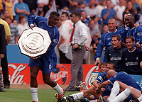 Marcel Desailly parades the Charity Shield in front of his Chelsea team mates. Chelsea v Manchester United. FA Charity Shield. Wembley 13/8/00. Credit: Colorsport.