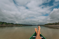 Feet up on the bow of a canoe on Montana's Yellowstone River.