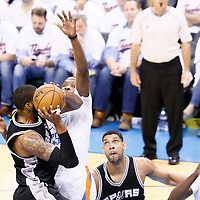 06 May 2016: San Antonio Spurs forward LaMarcus Aldridge (12) goes for the layup against Oklahoma City Thunder forward Kevin Durant (35) during the San Antonio Spurs 100-96 victory over the Oklahoma City Thunder, during Game Three of the Western Conference Semifinals of the NBA Playoffs at the Chesapeake Energy Arena, Oklahoma City, Oklahoma, USA.