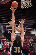 November 14, 2014; Stanford, CA, USA; Stanford Cardinal center Stefan Nastic (4, top) shoots the basketball against Wofford Terriers forward C.J. Neumann (31) during the first half at Maples Pavilion.