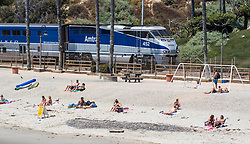June 14, 2017 - San Clemente, California, USA - An Amtrak train makes its way past beach goers near the San Clemente pier on Wednesday, June 14, 2017. The Heal the Bay's new beach report card lists the San Clemente Pier area in San Clemente, as one of the ten worst in the state for bacteria pollution.  (Photo by Mark Rightmire, Orange County Register/SCNG) (Credit Image: © Mark Rightmire, Mark Rightmire/The Orange County Register via ZUMA Wire)