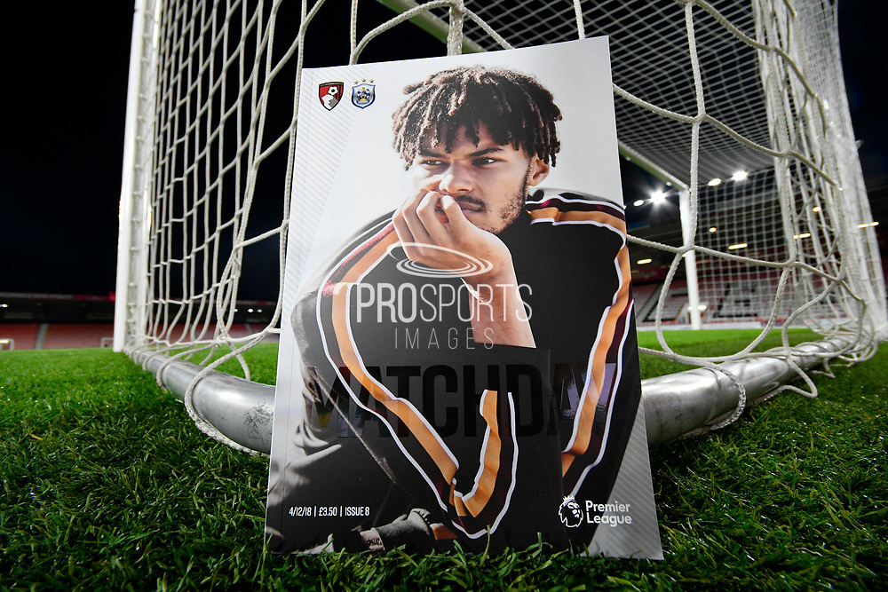 AFC Bournemouth Matchday programme with the front cover featuring a picture of Tyrone Mings (26) of AFC Bournemouth next to the net of the goal before the Premier League match between Bournemouth and Huddersfield Town at the Vitality Stadium, Bournemouth, England on 4 December 2018.