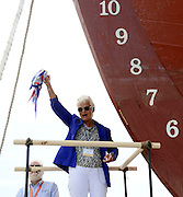 Sarah Bullard, the great-great-great granddaughter of Charles Waln Morgan, christens the ship bearing her ancestor's name by breaking a bottle containing waters from all the oceans visited by the ship during its original 37 voyages, plus a touch of rum for good luck, across the bow of the shiop as the Mystic Seaport launches the historic whaleship Charles W. Morgan into the waters of the Mystic River Sunday July 21, 2013 at the seaport's H.B. duPont Preservation Shipyard. The launch takes place in the 172nd anniversary of the ship's original launch in 1841 in New Bedford, Massachusetts. The Morgan, the last remaining wooden whaling ship remaining and the oldest American commercial vessel still in existence as well as a National Historic Landmark, is slated to embark on its 38th voyage, a tour of historic New England ports, in the spring and summer of 2014.  (Sean D. Elliot/The Day)