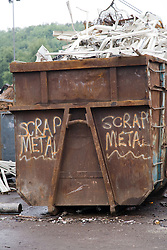 Skip full of scrap metal at a metal recycling centre,