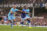 defender Vincent Kompany battles with forward Romelu Lukaku during the Barclays Premier League match between Everton and Manchester City at Goodison Park, Liverpool, England on 23 August 2015. Photo by Simon Davies.