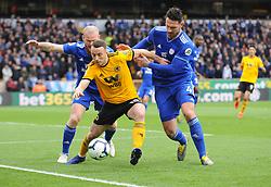 Diogo Jota of Wolverhampton Wanderers trees to hold off Sean Morrison  and Aron Gunnarsson of Cardiff City - Mandatory by-line: Nizaam Jones/JMP - 02/03/2019 - FOOTBALL - Molineux - Wolverhampton, England -  Wolverhampton Wanderers v Cardiff City - Premier League