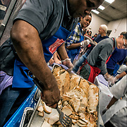 Chef Albert Lovelace checking turkey trays for Thanksgiving dinner.<br />