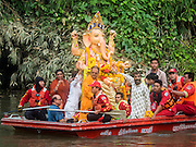 20 SEPTEMBER 2015 - SARIKA, NAKHON NAYOK, THAILAND:  The Ganesha deity on a boat at the Ganesh festival at Shri Utthayan Ganesha Temple in Sarika, Nakhon Nayok. Ganesh Chaturthi, also known as Vinayaka Chaturthi, is a Hindu festival dedicated to Lord Ganesh. Ganesh is the patron of arts and sciences, the deity of intellect and wisdom -- identified by his elephant head. The holiday is celebrated for 10 days. Wat Utthaya Ganesh in Nakhon Nayok province, is a Buddhist temple that venerates Ganesh, who is popular with Thai Buddhists. The temple draws both Buddhists and Hindus and celebrates the Ganesh holiday a week ahead of most other places.   PHOTO BY JACK KURTZ
