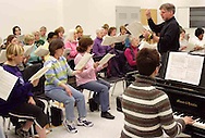 With Amy Gray at the piano, Hank Dahlman leads the women of the Dayton Philharmonic Chorus as they rehearse for their upcoming performance of Mahler's Third Symphony, Tuesday, January 2, 2007.