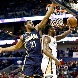 Dec 15, 2016; New Orleans, LA, USA; New Orleans Pelicans guard Buddy Hield (24) shoots over Indiana Pacers forward Thaddeus Young (21) during the second half of a game at the Smoothie King Center. The Pelicans defeated the Pacers 102-95. Mandatory Credit: Derick E. Hingle-USA TODAY Sports