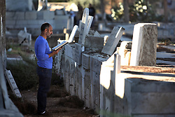 60599849 <br />  A Palestinian man visits the cemeteries on the first day of the Muslim festival Eid Al-Adha in the West bank city of Bethlehem on Oct. 15, 2013. Muslims across the world celebrate the festival of Eid al-Adha, or the Festival of Sacrifice, in commemoration of Prophet Abraham s readiness to sacrifice his son to show obedience to God, Tuesday October. 15, 2013. Picture by imago /  i-Images<br /> UK ONLY