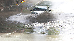 LIVERPOOL, ENGLAND - Tuesday, July 29, 2008: Traffic on Queens Drive Mossley Hill passes slowly through after a deep flood following the thunder showers that hit South Liverpool on Tuesday afternoon. (Photo by David Rawcliffe/Propaganda)