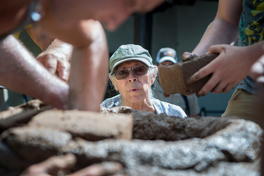 em071917a/jnorth/Felipe Ortega, from La Madera, instructs a team building a horno in the courtyard of the Palace of the Governor's in Santa Fe, Wednesday July 19, 2017. (Eddie Moore/Albuquerque Journal)